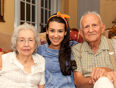caregiver and two senior couple